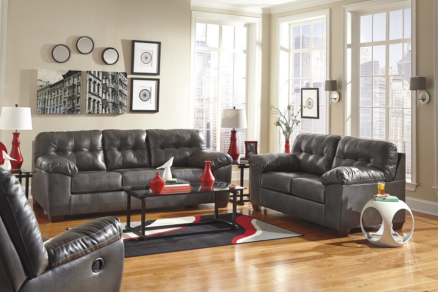 Grey Wood Flooring With Brown Leather Couch