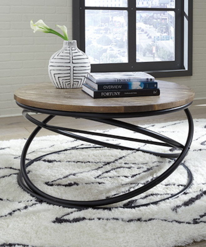 Ashley Brookfield Round Coffee Table In Dark Brown: T644-8 Charliburi Ashley Round Cocktail Table Brown Black