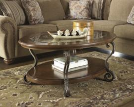 T517-0 Nestor by Ashley Oval Cocktail Table In Medium Brown